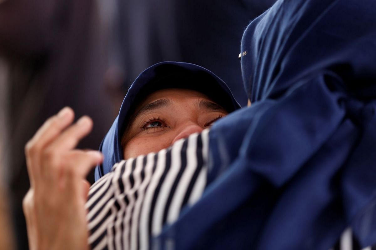 A woman cries at Bhayangkara R. Said Sukanto hospital in Jakarta on Oct 30, 2018.