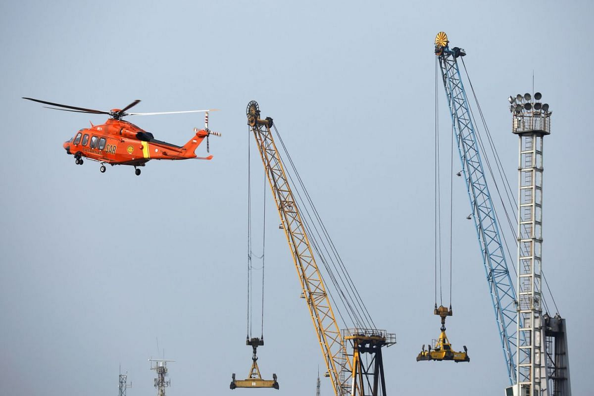 A search and rescue helicopter arrives at Tanjung Priok port, where the operations for the crashed Lion Air Flight JT610 are based, on Oct 30, 2018.