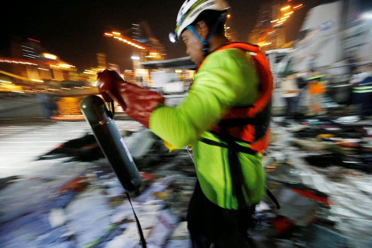 An Indonesian rescue team member carries a recovered plane oxygen tube at Tanjung Priok port in Jakarta on Oct 29, 2018.