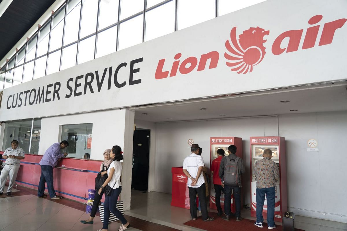 Customers use ticket machines at the Lion Air customer service area at Soekarno-Hatta International Airport in Cengkareng, Jakarta, on Oct 29, 2018.
