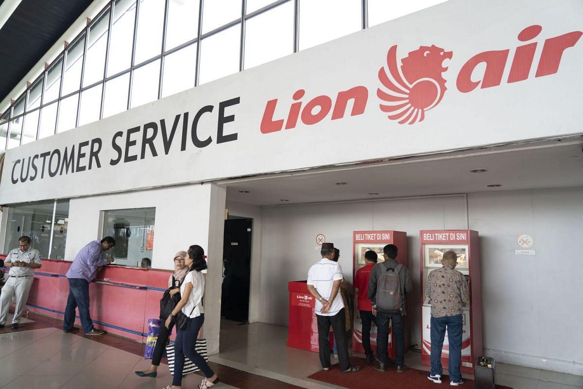 Customers use ticket machines at the Lion Air customer service area at Soekarno-Hatta International Airport in Cengkareng, Jakarta, on Oct 29, 2018.