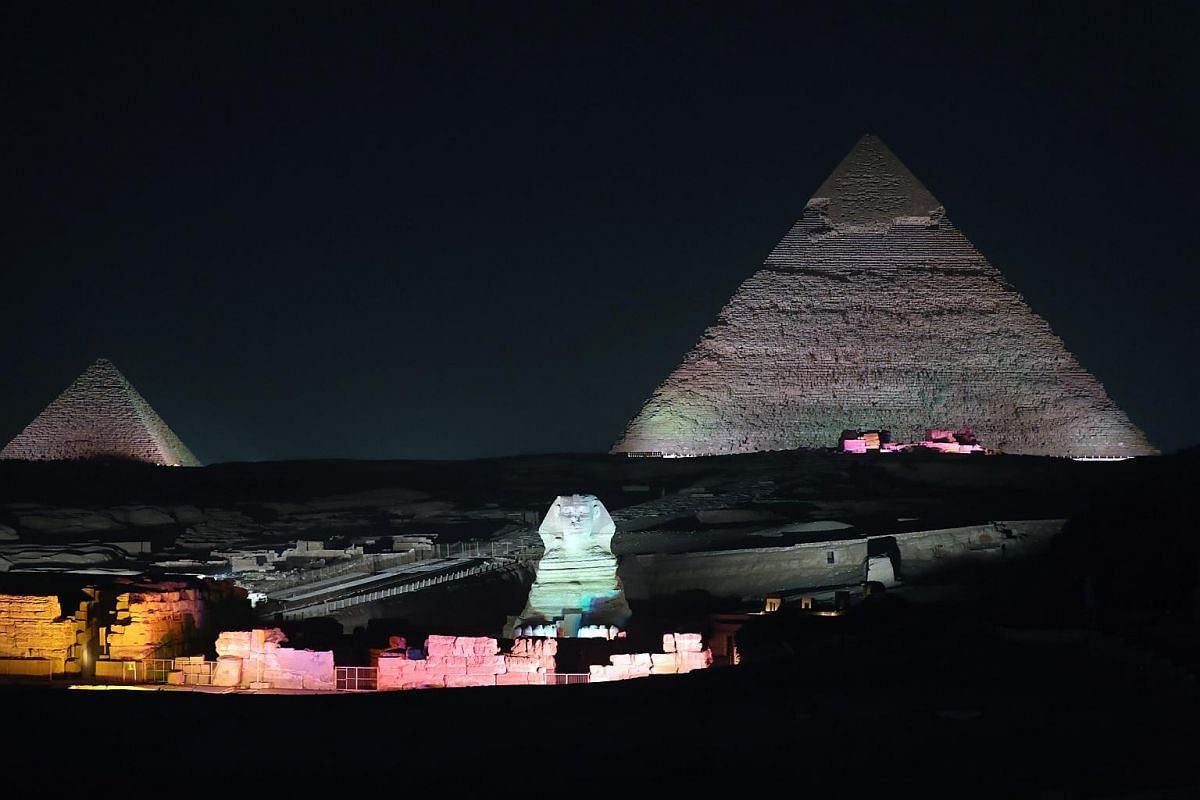 The Sphinx is lit up in front of the Great Pyramids during the Sound and Light show at the Giza Pyramids plateau, in Giza, Egypt, on Oct 29, 2018.