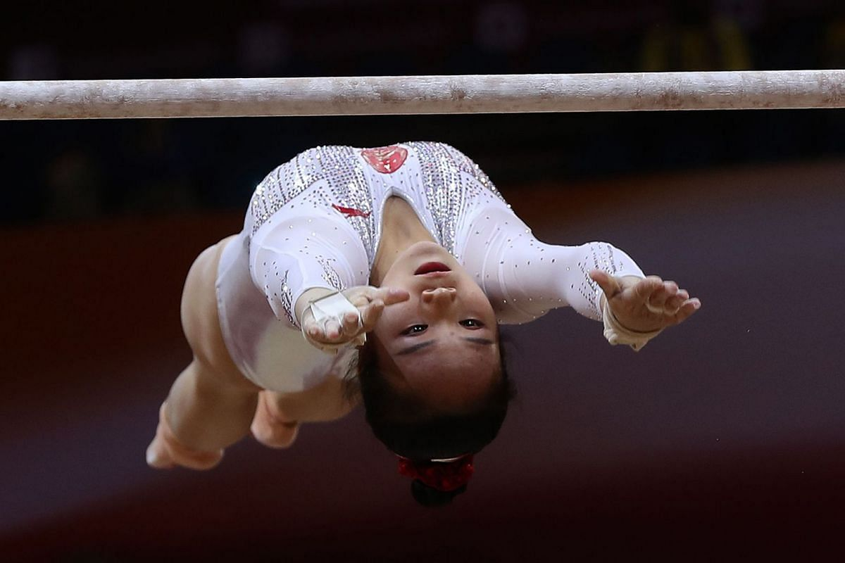 Huan Luo of China competes in the uneven bars during women's team final of the 2018 FIG Artistic Gymnastics Championships at Aspire Dome on October 30, 2018 in Doha, Qatar.