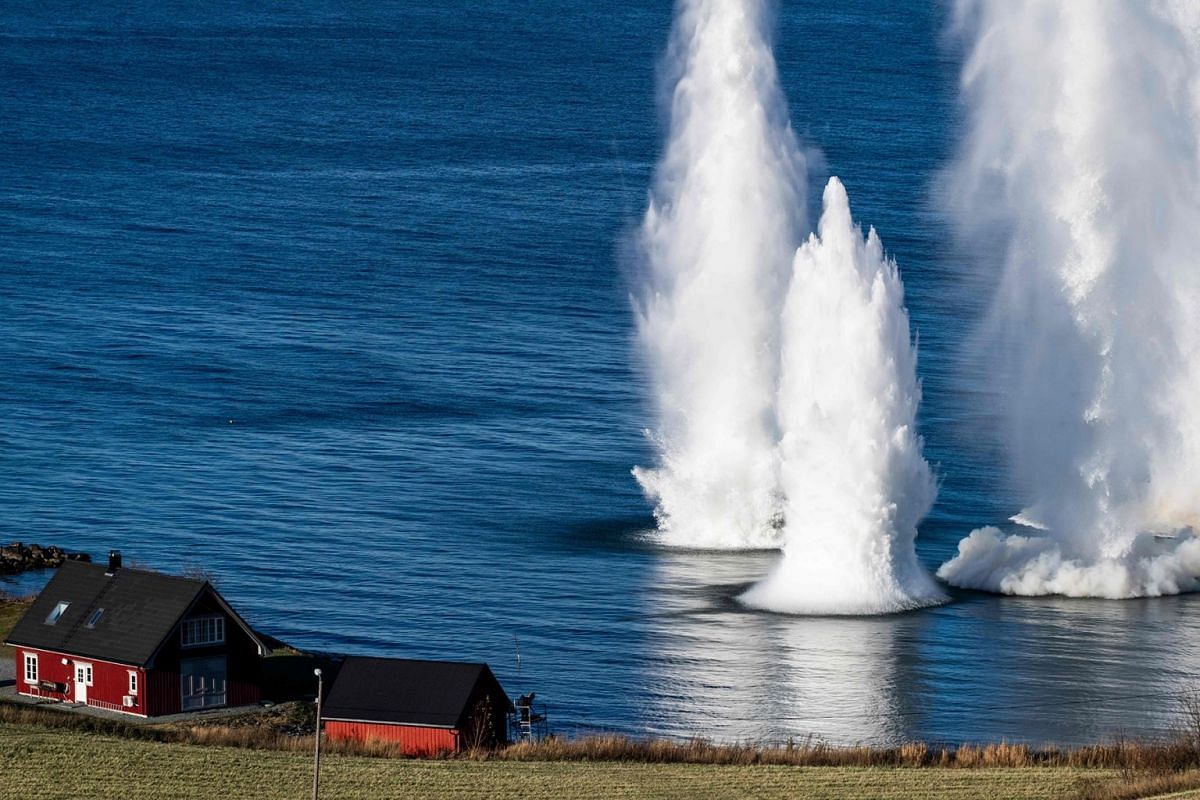 Explosives planted by Norwegian Naval Explosive Ordnance Disposal are triggered to clear the beaches of obstacles and enemy mines, during an Intelligence Surveillance and Reconnaissance demonstration, as part of the NATO exercise Trident Juncture 201