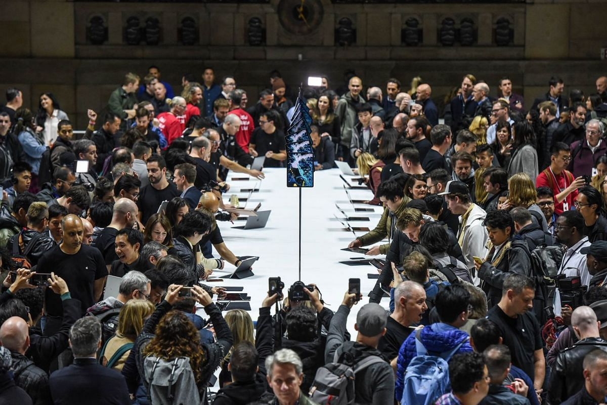 People test the new the new Apple products during an Apple launch event at One Hanson Place on October 30, 2018 in the Brooklyn borough of New York City. Apple debuted a new MacBook Pro, Mac Mini and iPad Pro.
