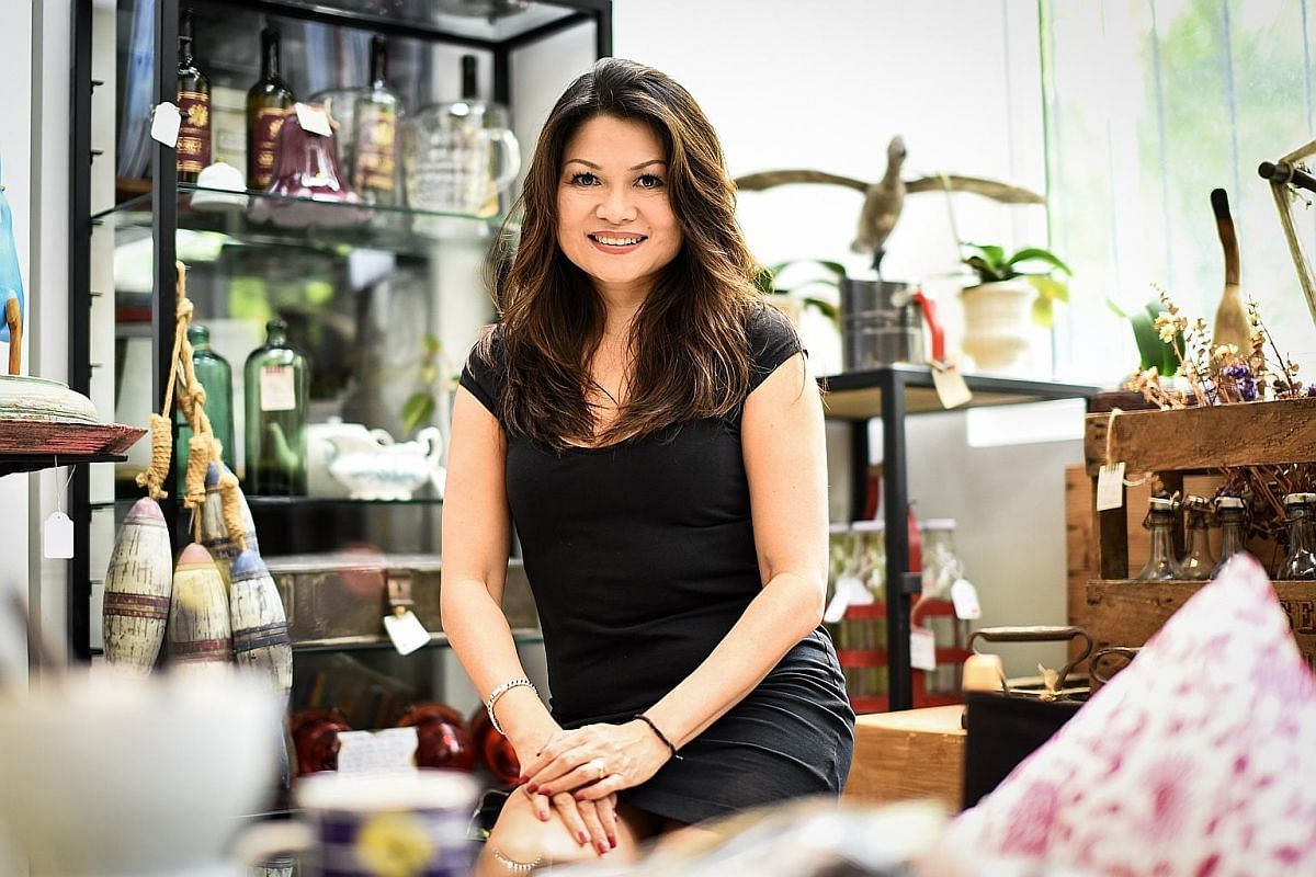 Second-hand goods dealer Hock Siong & Co's warehouse (left and above) features furniture styled and displayed in eye-catching ways. The GoDown founder Audrey Lee (above) designed her shop to feature vintage furniture pieces and home decor items in ev