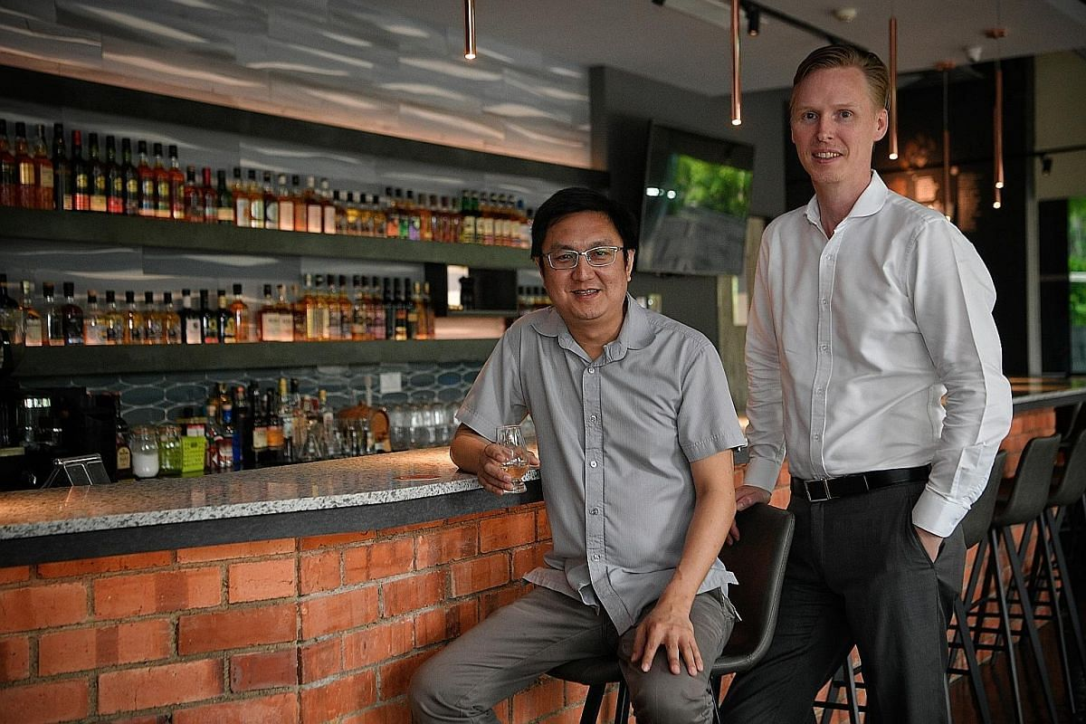 Whisky by the carafe starts at $50. Mr Chua Khoon Hui with Mr Matthew Fergusson-Stewart (both left) from The Whisky Store, which runs The Copper Plate.
