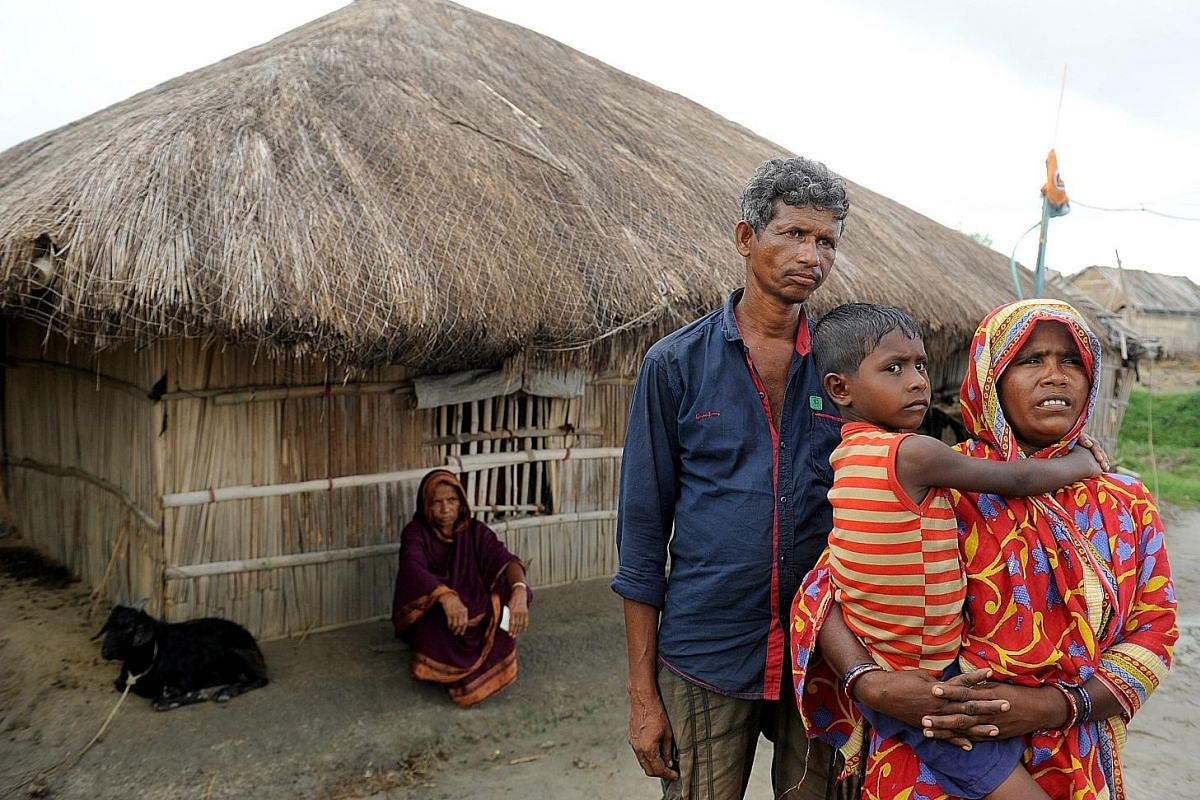 Mr Sheikh Sofi (above) and his family had to evacuate from his house (top) because it was too risky to live in. Left: Ms Akhtaroon Bibi in front of her new brick house that was built after her old mud one was washed away by the sea. Above: Waves cras