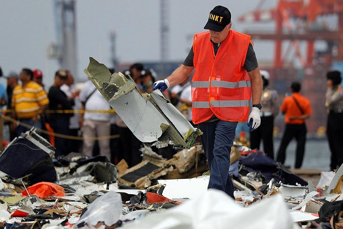 A staff member of Indonesia's National Transportation Safety Board examining debris from Flight JT610 at Tanjung Priok port in Jakarta on Thursday. While flying is becoming safer, there are still areas of concern, said the International Air Transport