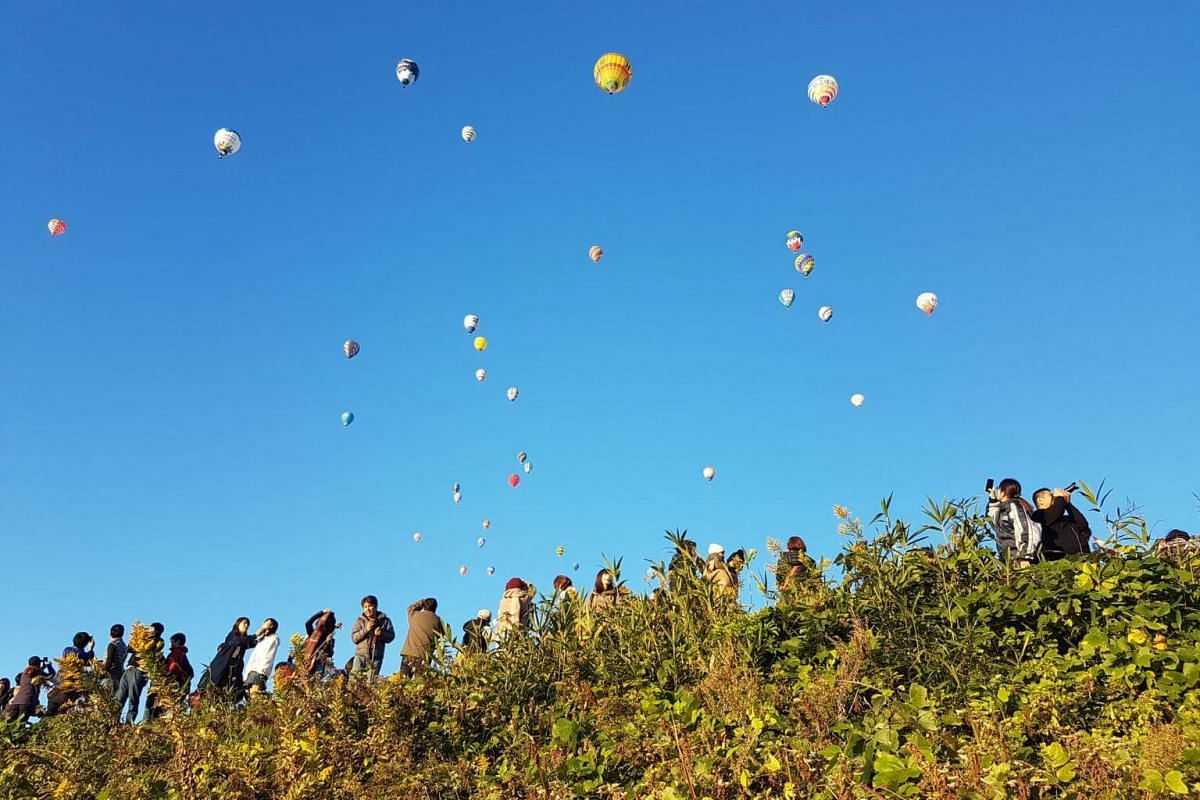 Crowds gathered on both sides Balloons of the Kasegawa River during the morning run of the competition at the Saga International Balloon Fiesta on Nov 3, 2018.