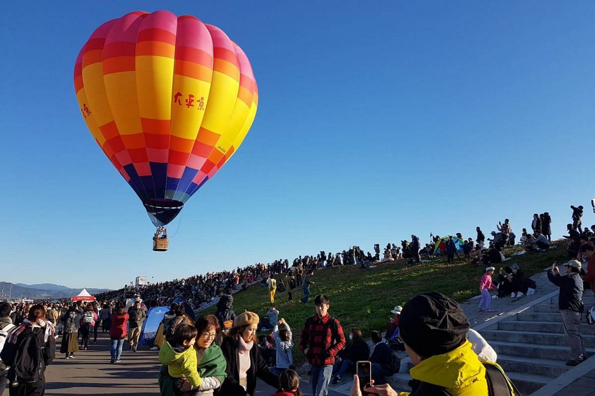 A balloon comes close to the audience before taking off during the morning run of the competition at the Saga International Balloon Fiesta on Nov 3, 2018.