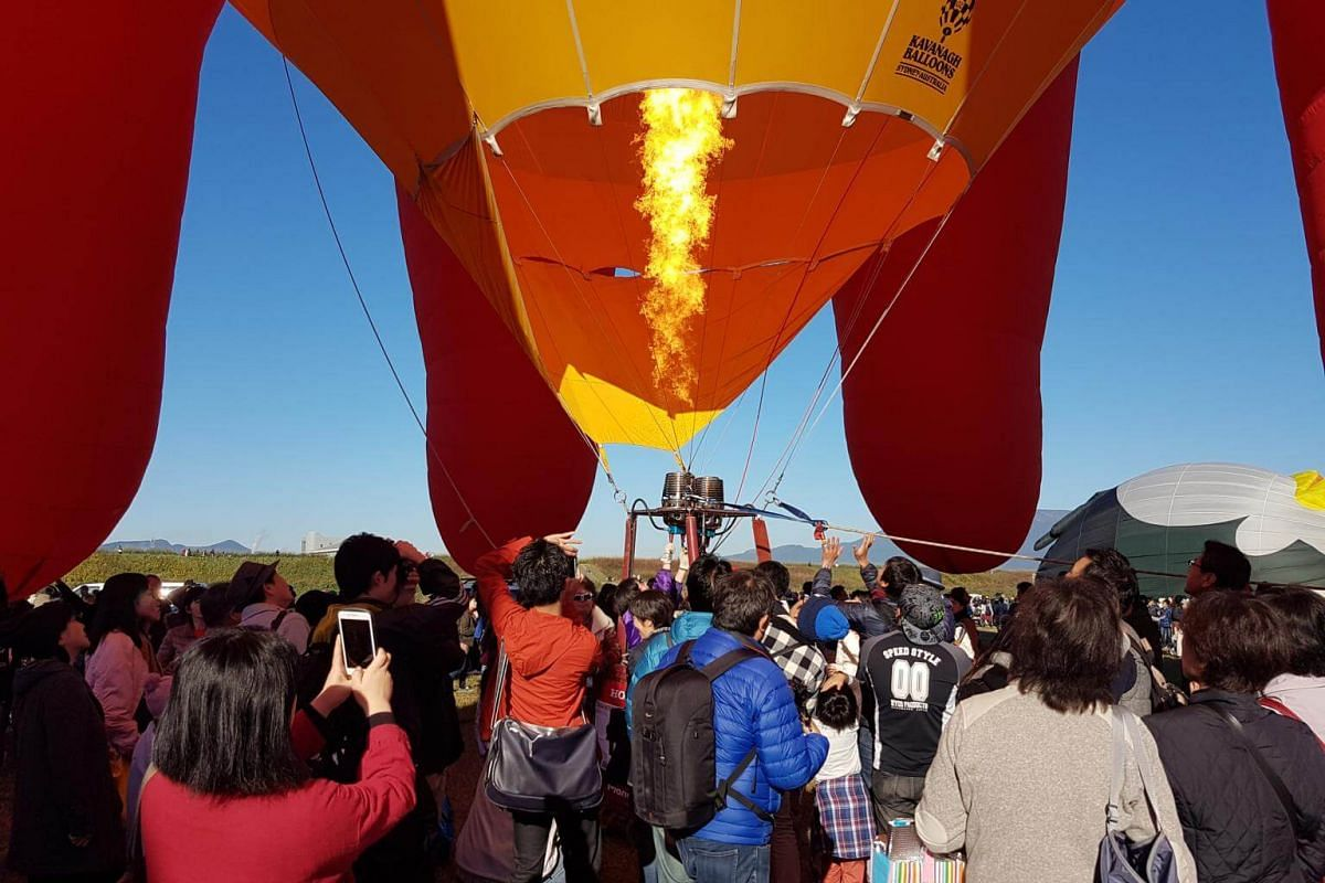 The burner is turned on for an octopus balloon as enthusiastic participants crowd to get a glimpse during the Balloon Fantasia segment on Nov 3, 2018.