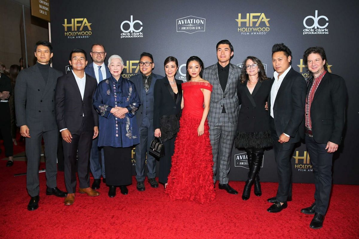 Crazy Rich Asians cast and crew (from left) Harry Shum Jr., Ronny Chieng, Bradford Simpson, Lisa Lu, Nico Santos, Michelle Yeoh, Constance Wu, Henry Golding, Nina Jacobson, Jon M. Chu and John Penotti at the 22nd annual Hollywood Film Awards in Bever