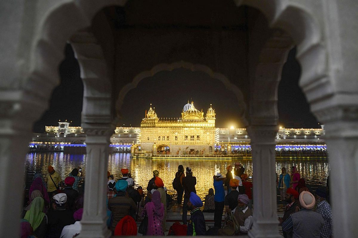 Indian Sikh devotees gathering to pay their respects on the eve of Bandi Chhor Divas, or Deepavali, at the Golden Temple in Amritsar on Nov 6, 2018.
