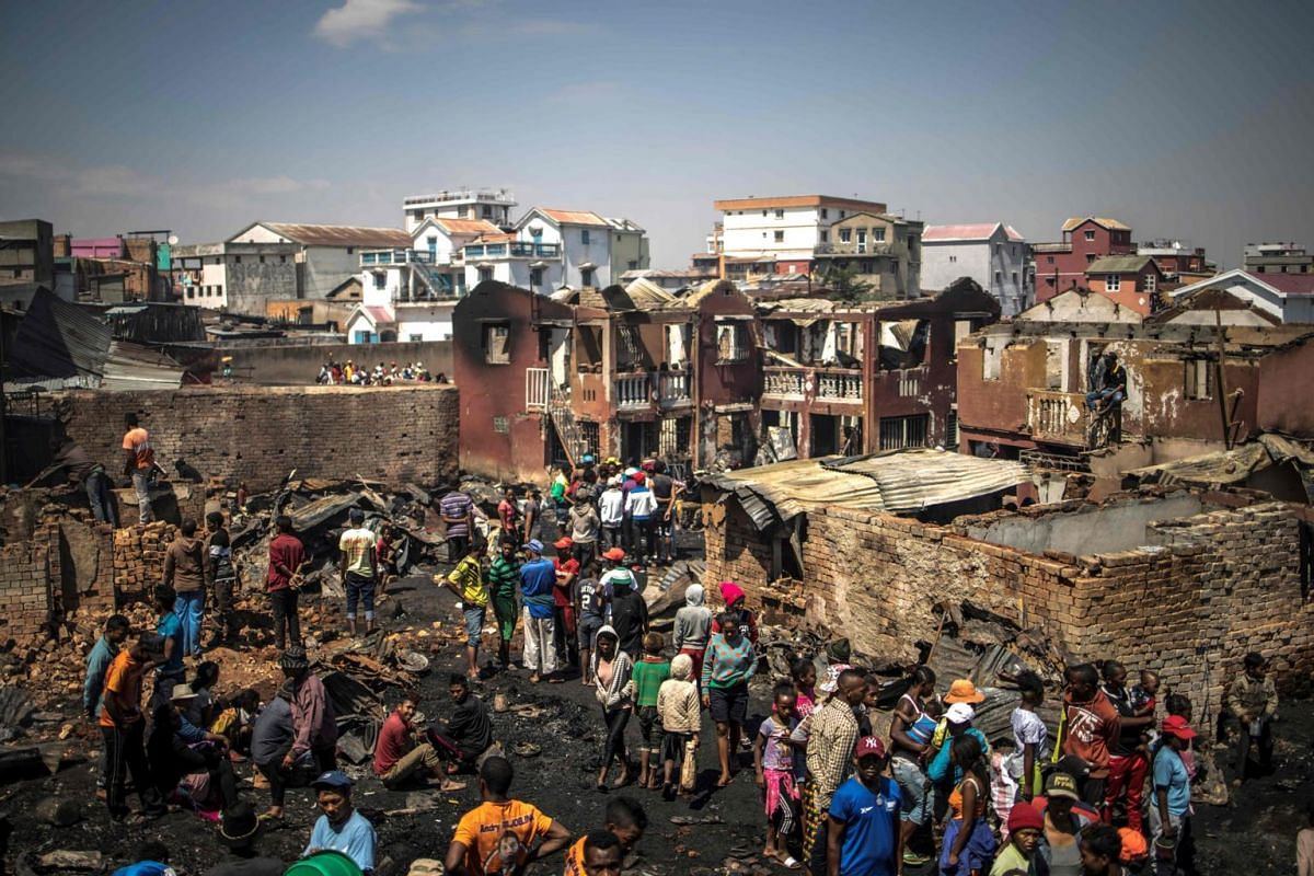 Residents trying to salvage their belongings after a fire that ravaged a section of the Anosibe central market in Antananarivo, Madagascar, on Nov 8, 2018.