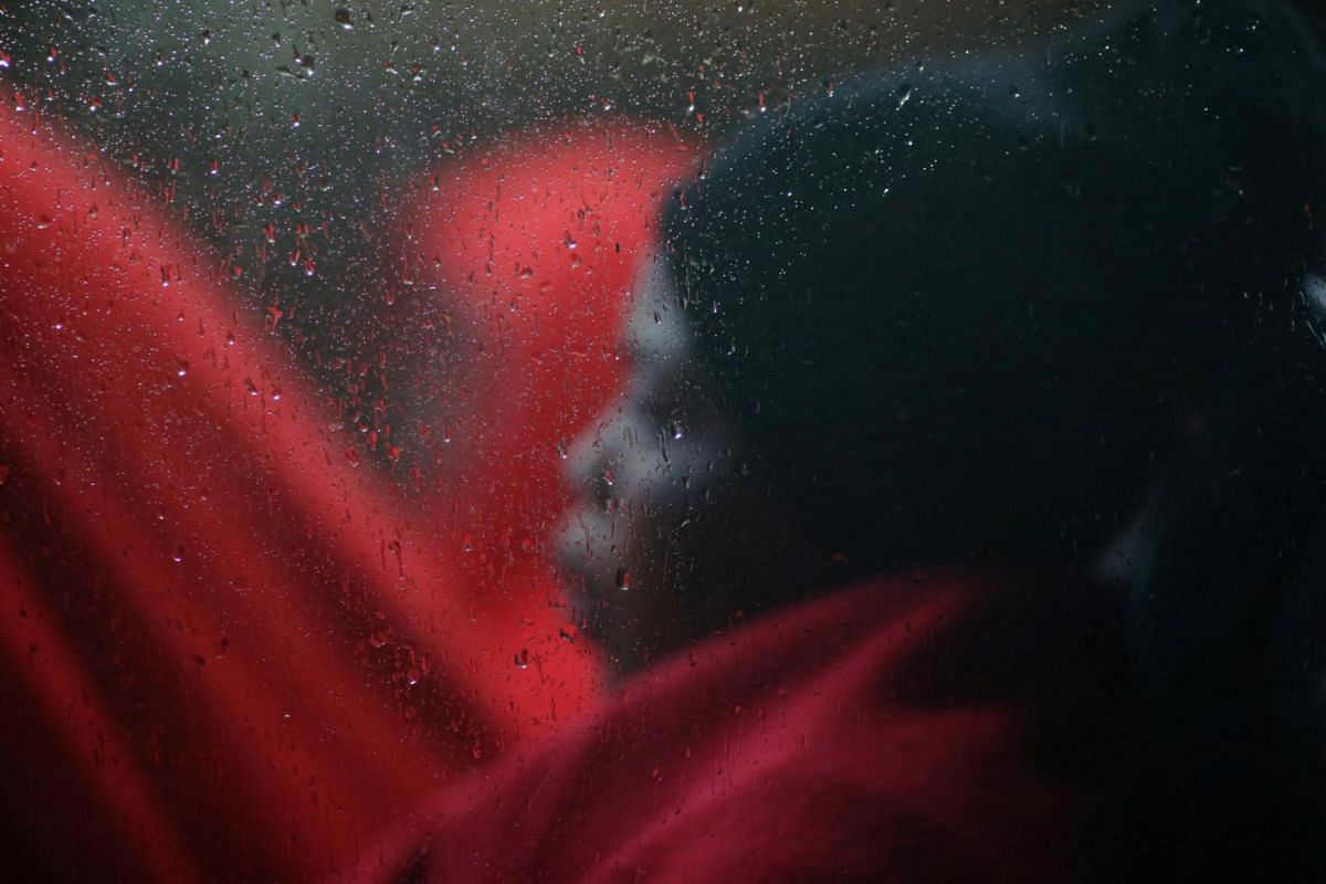 A migrant woman, intercepted off the coast of the Mediterranean Sea, sitting in a bus after disembarking from a rescue boat at the port of Malaga, Spain, on Nov 8, 2018.