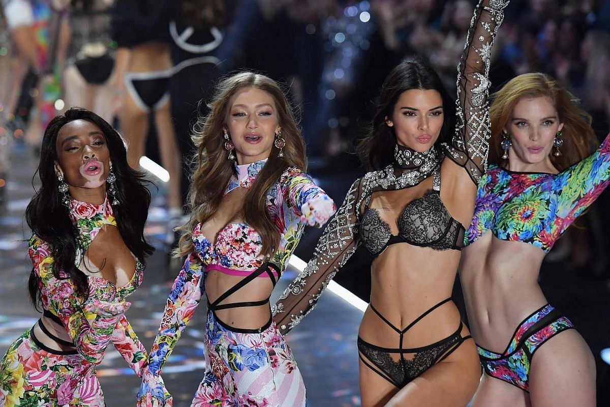(From left) Canadian model Winnie Harlow, US models Gigi Hadid and Kendall Jenner, and British model Alexina Graham posing on the runway at the 2018 Victoria's Secret Fashion Show on Nov 8, 2018.