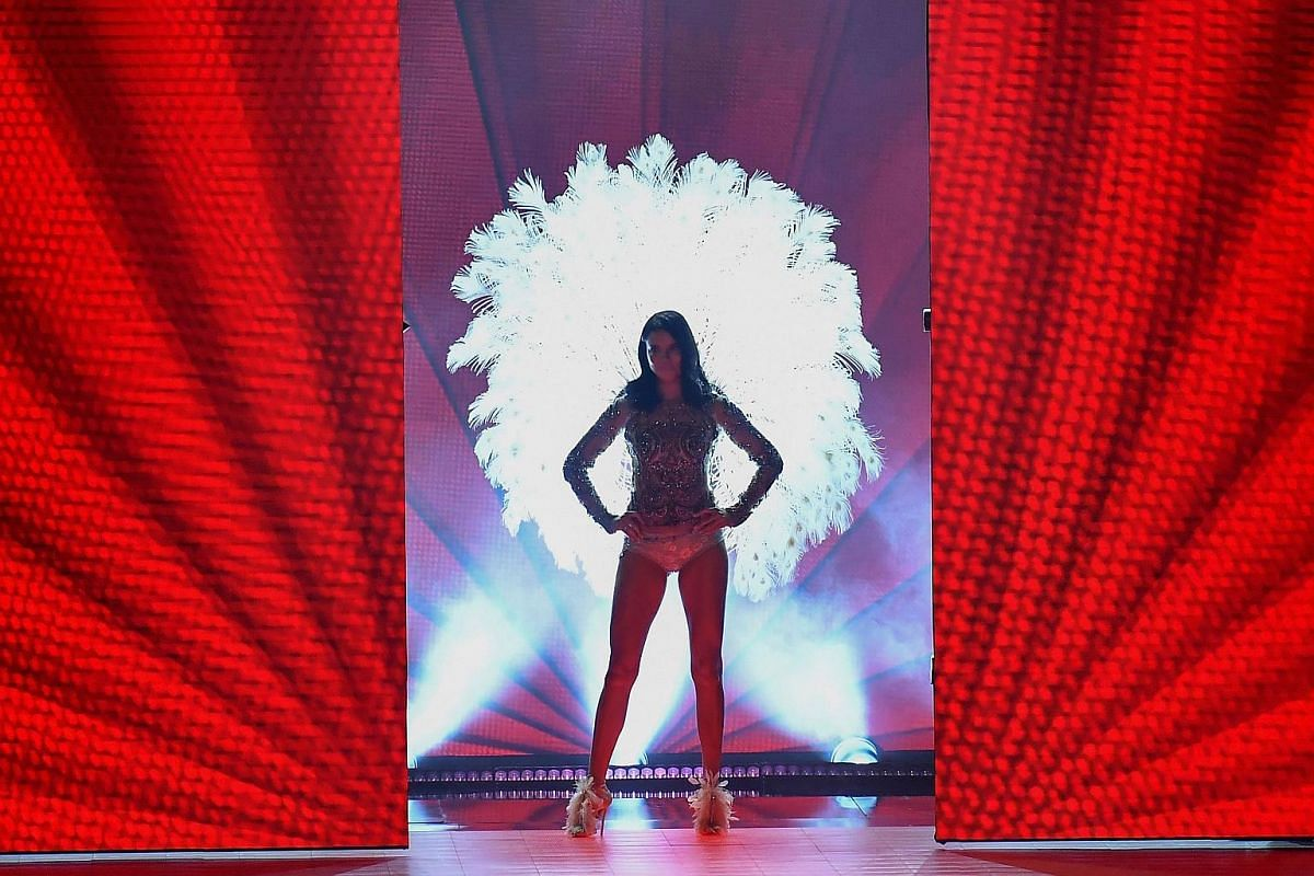 Brazilian model Adriana Lima strikes a dramatic pose in this feathery outfit.