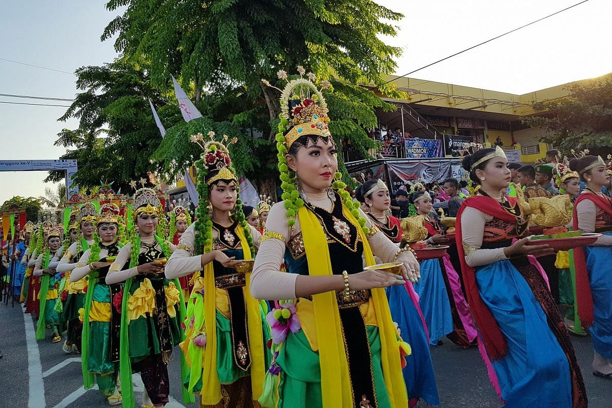 Above and left: Representatives from several Indonesian kingdoms marching during the opening ceremony of the annual Asean Palaces and Indigenous Peoples festival on Oct 28 in Sumenep. Chairman of the Indonesian Royal Palace Forum, and Sultan of Cireb