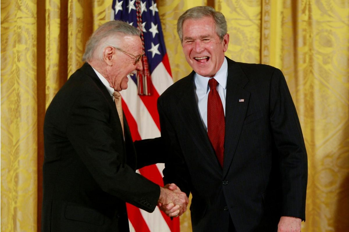 Stan Lee with then US President George W. Bush at a ceremony in which Lee was presented with a National Medal of Arts at the White House in Washington on Nov 17, 2008.