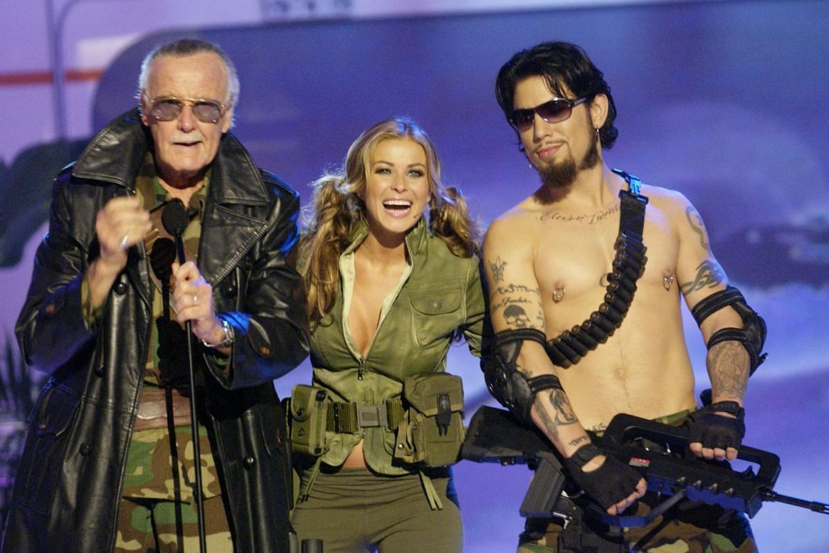 Stan Lee with hosts Carmen Electra and Dave Navarro during G-Phoria - The Award Show 4 Gamers at the Shrine Auditoreum in Los Angeles on July 31, 2004.