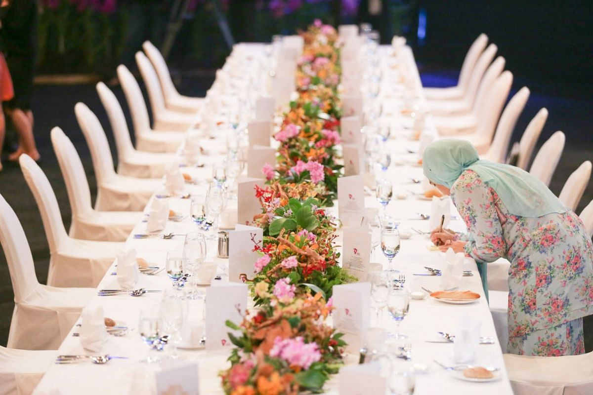 A person makes notes at the table where delegates sit before the Asean Summit gala dinner hosted by Prime Minister Lee Hsien Loong at Suntec Convention Centre.