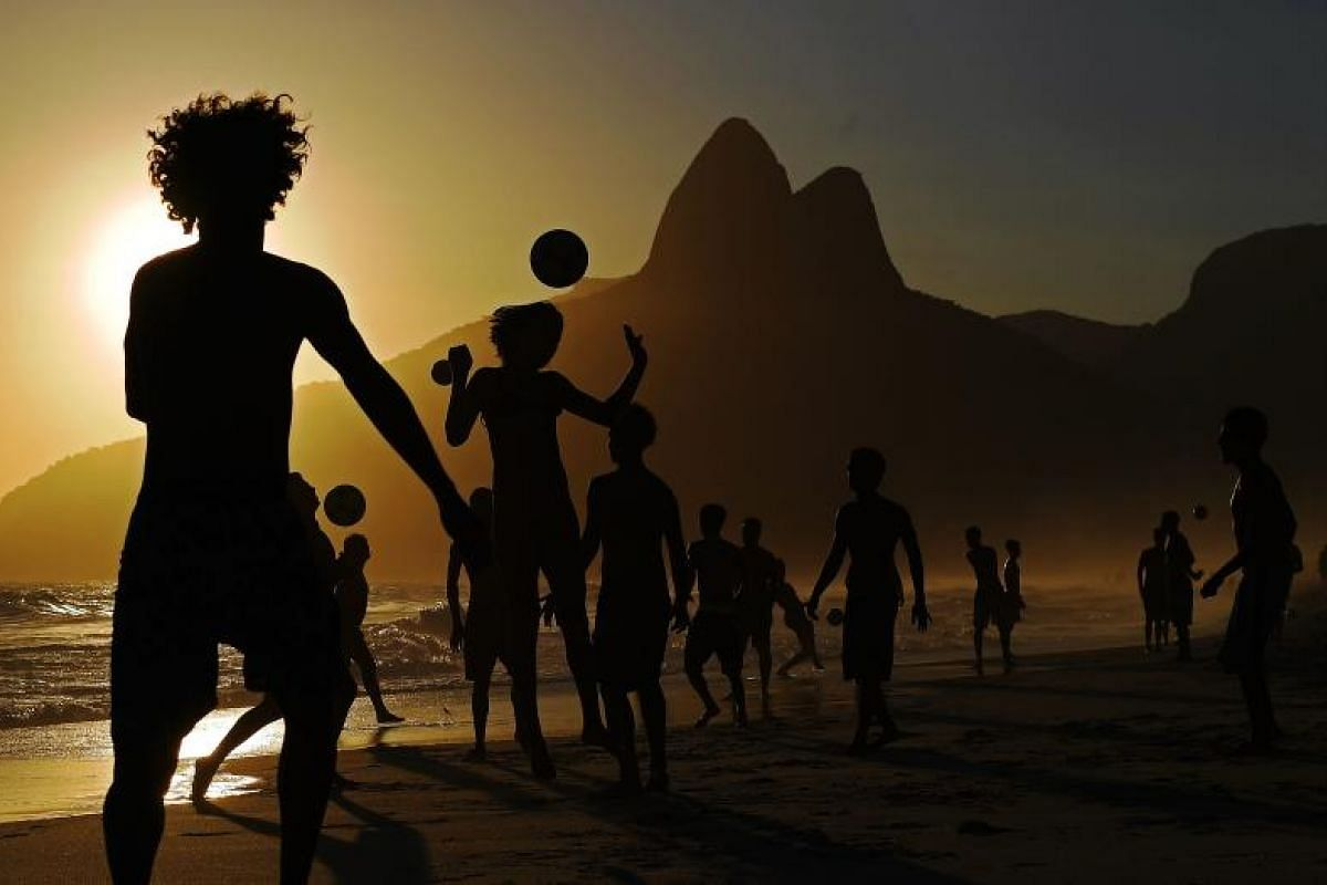 Youngsters play football at Ipanema beach in Rio de Janeiro, Brazil. PHOTO:AFP