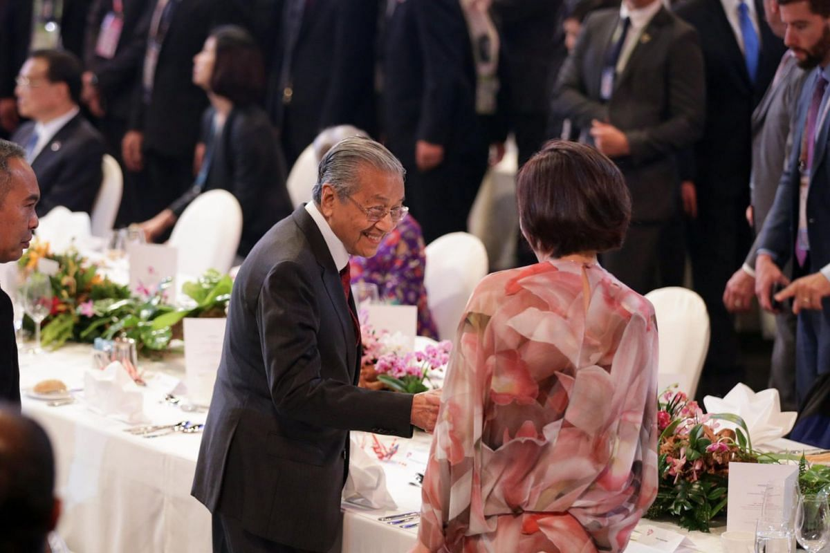 Dr Mahathir Mohamad, Prime Minister of Malaysia (left), greets Mrs Akie Abe, wife of Japan's Prime Minister Shinzo Abe.