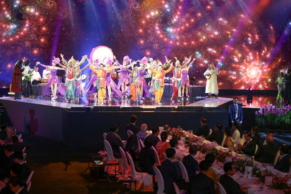Performers entertain the world leaders gathered at the dinner.