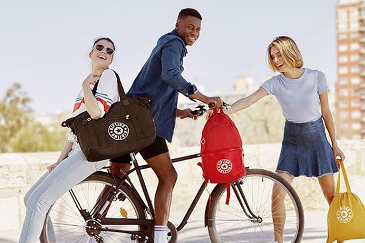 New Kipling designs in simpler silhouettes with the new logo.
