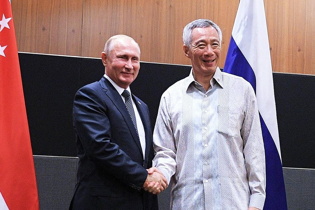 On Wednesday, PM Lee met Russian President Vladimir Putin (top left) and reaffirmed their countries' broad-based and longstanding friendship. He also met Indian Prime Minister Narendra Modi (above) that day. They agreed to keep up the momentum toward