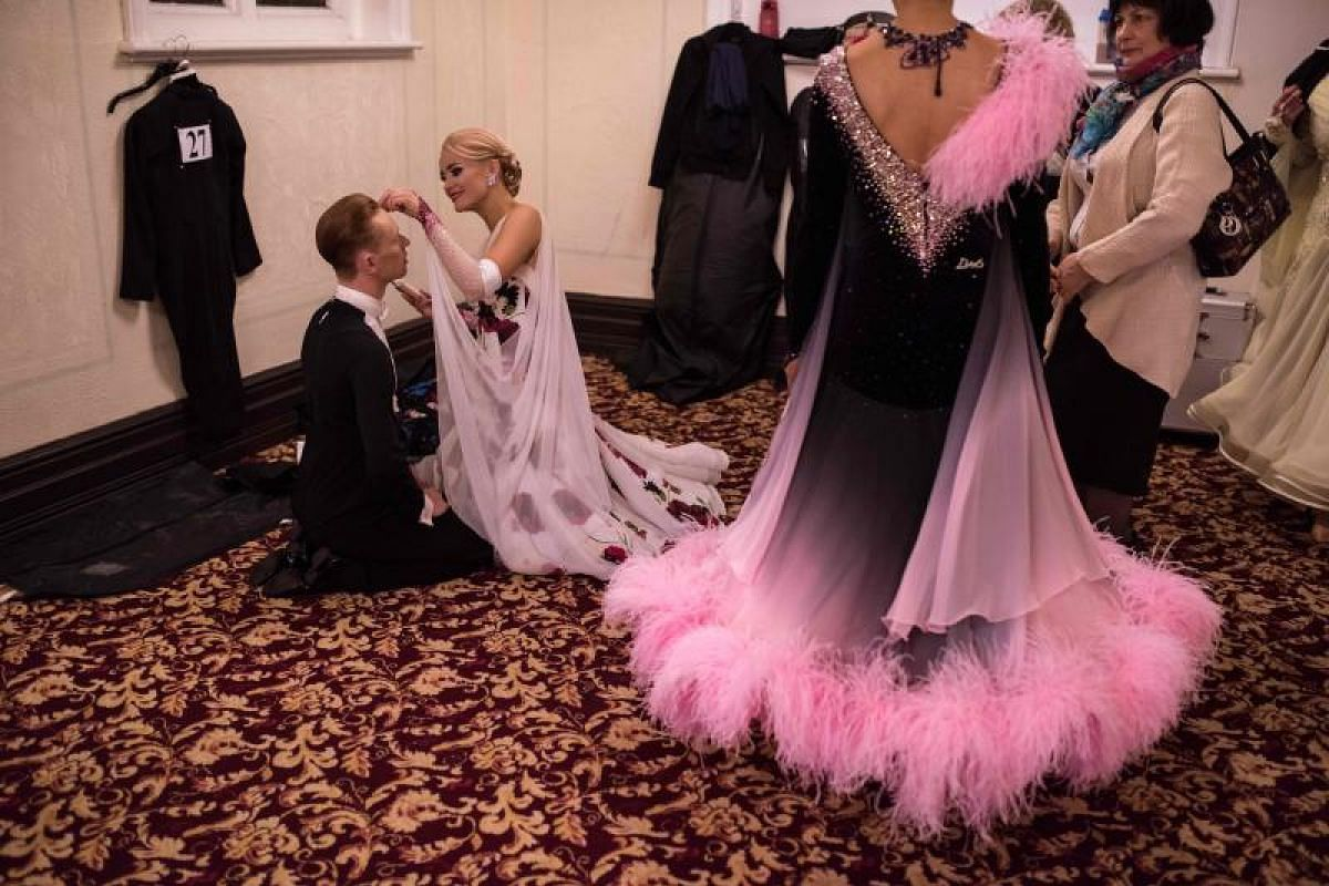 Ballroom dancers prepare to compete at the British National Dance Championships in the Empress Ballroom of Blackpool's Winter Gardens on Nov 15, 2018 in Blackpool, England.The three-day British National Dance Championships have been taking place sinc