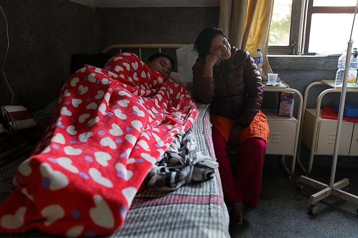 Dengue patient Kul Bahadhur Poudel, 33, with his wife Saradha at the Sukraraj Tropical and Infectious Disease Hospital in Kathmandu. Large dengue outbreaks have hit Nepal every three years like clockwork. Ratnanagar near Bharatpur in Nepal experience