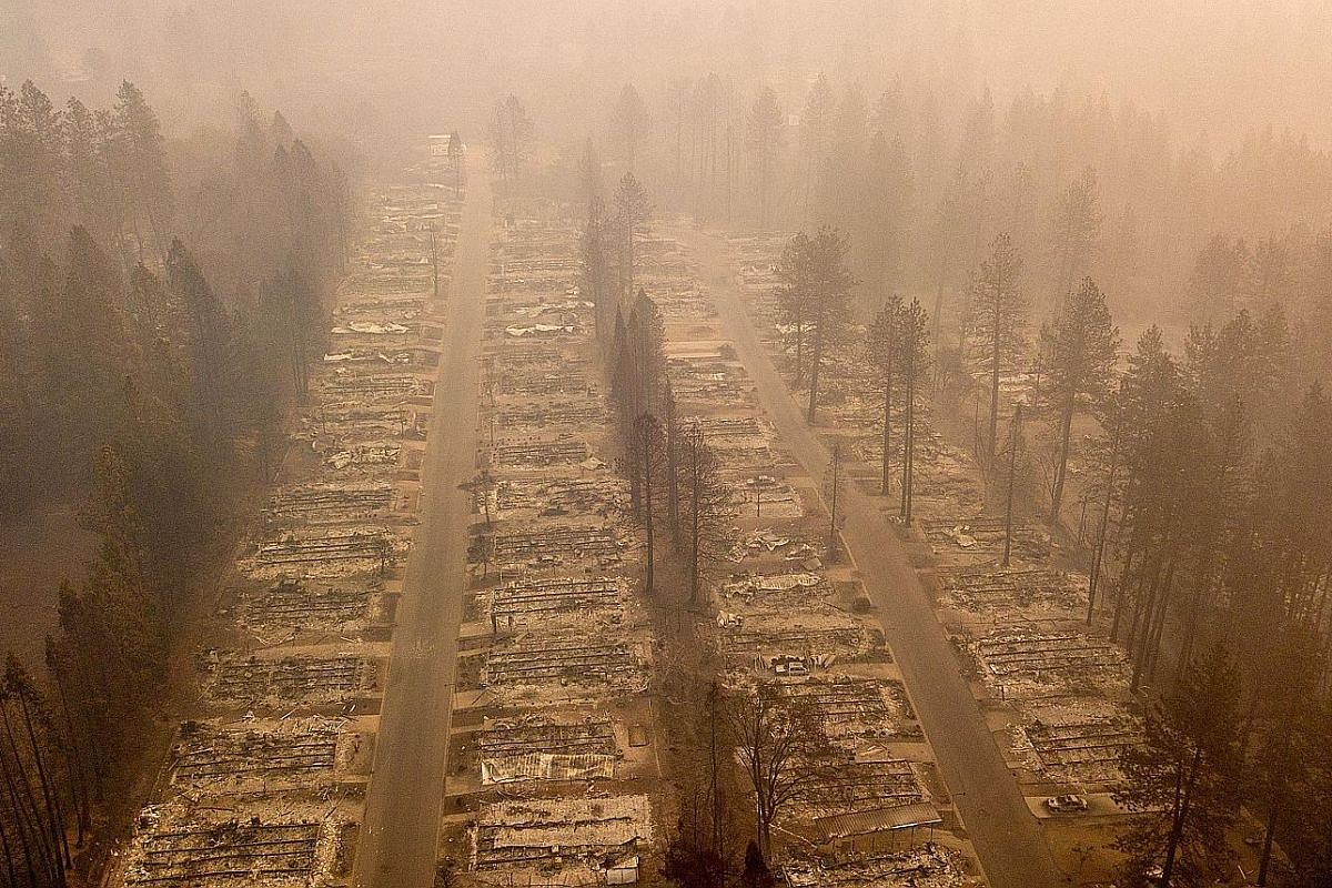 An aerial photo showing the razed neighbourhood in Paradise, California. The smoke was so thick that health warnings led to the widespread closure of schools in San Francisco, 320km away.