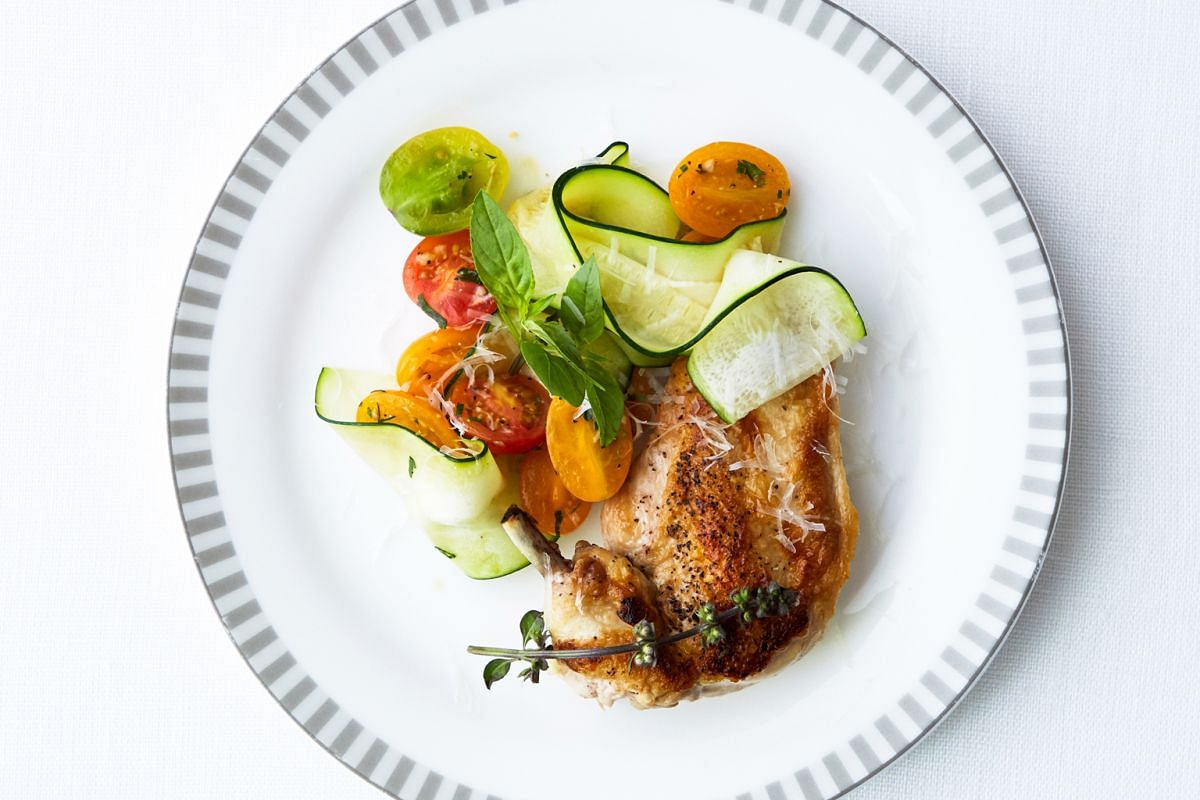 Above: Seared chicken with pasta-cut zucchini, Parmesan, basil and braised tomatoes is on the menu created by spa Canyon Ranch for Singapore Airlines' Newark- Singapore route.