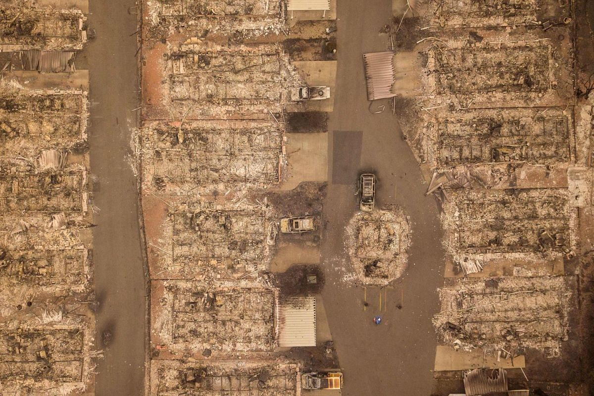 In this aerial photo, a burned neighborhood is seen in Paradise, California, on November 15, 2018. - The toll in the deadliest wildfires in recent California history climbed to 59 on November 14, 2018, as authorities released a list of 130 people sti