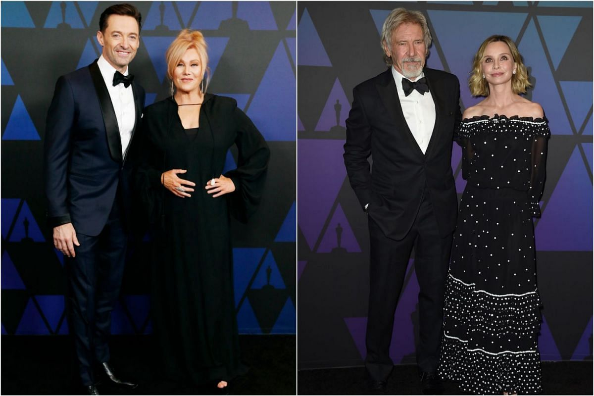 Actor-producer Hugh Jackman with wife, Australian actress Deborra-lee Furness, and Star Wars star Harrison Ford with wife, actress Calista Flockhart.