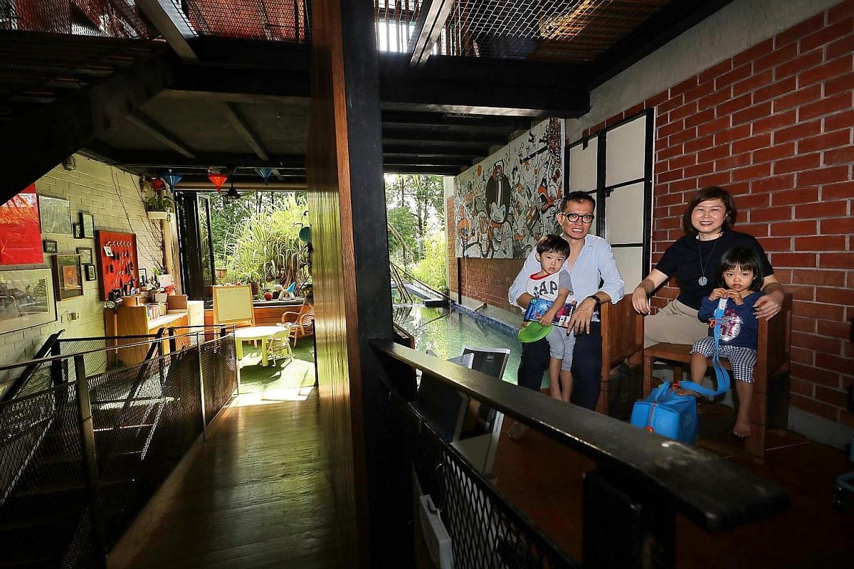 An open-concept design (above) encourages plenty of cross-ventilation in the intermediate terrace house of Mr Randy Chan and his wife Jancy Rahardja (left, with their children Zachary and Ariel).