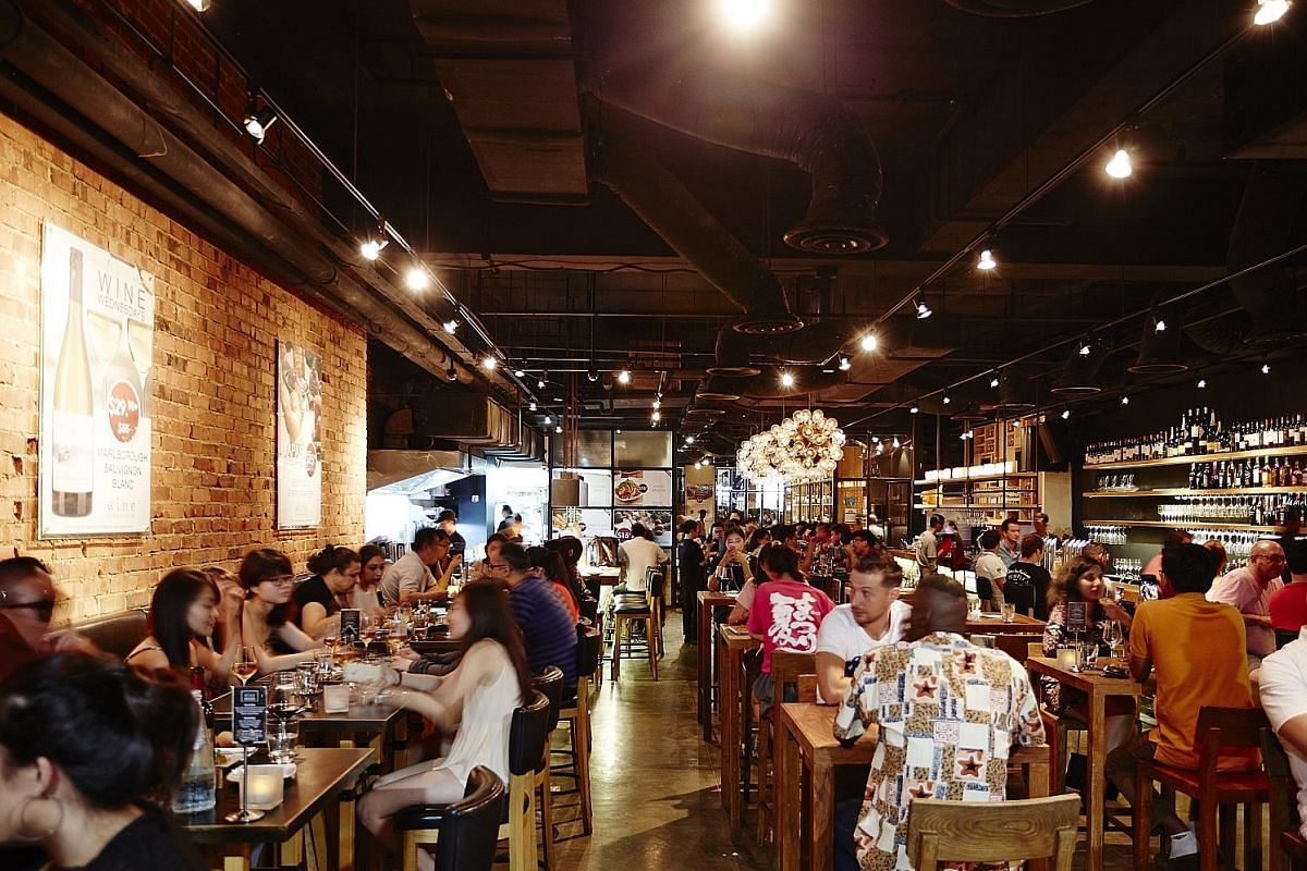 The Wine Connection Tapas Bar & Bistro at Robertson Walk (above) is among its most popular outlets. Ms Caroline Simon (left) is the company's managing director for Singapore and Malaysia.