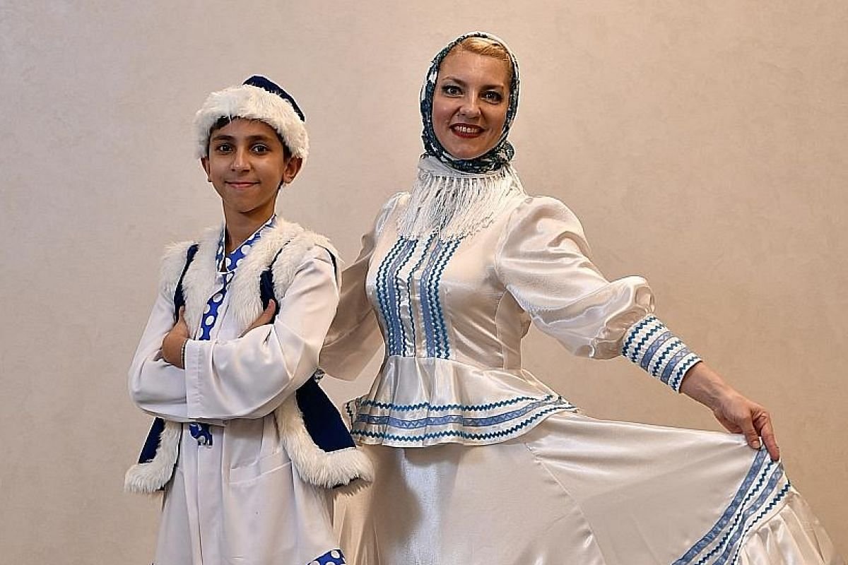 Ms Lioudmila Terentieva, seen here with her son Aaron Singh Sirna, 12, founded the Rossinochka Russian Dance Studio.