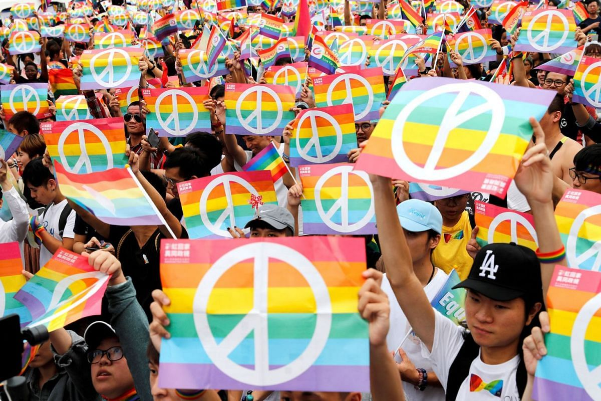 Same-sex marriage supporters take part in a lesbian, gay, bisexual and transgender (LGBT) pride parade after losing in the marriage equality referendum, in Kaohsiung, Taiwan, November 25, 2018.