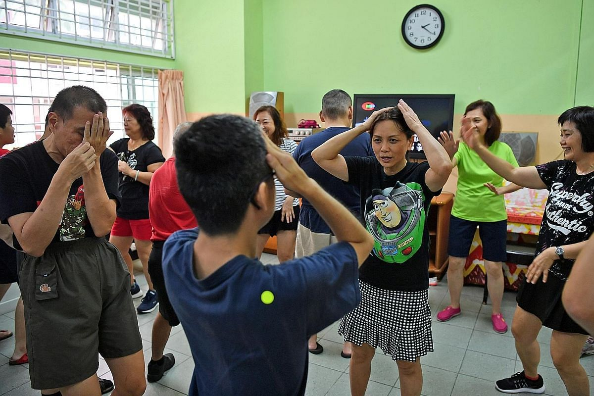 Members of the Dance Ladies group, Ms Jean Pang (centre), Ms Heng Ah Boey (in green top) and Ms Trina Teng (right), teaching dance moves to the tune of the hit Spanish song, Macarena, at Sun-Dac, a charity which serves people with intellectual disabi