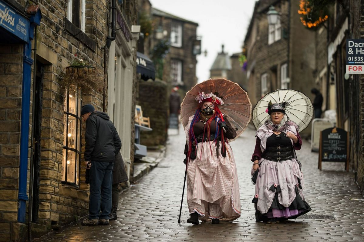 Steampunk enthusiasts attend the sixth annual Haworth Steampunk Weekend in Haworth, northern England on November 25, 2018. The three-day alternative lifestyle festival features: music, dancers, entertainers, burlesque performers, vintage vehicles, a