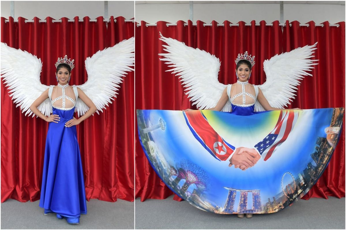 This year's Miss Universe Singapore national costume consists of 3m-long white dove wings, a peace symbol incorporated into the bodice and an electric blue skirt emblazoned with a digital print of a handshake over the Singapore skyline.