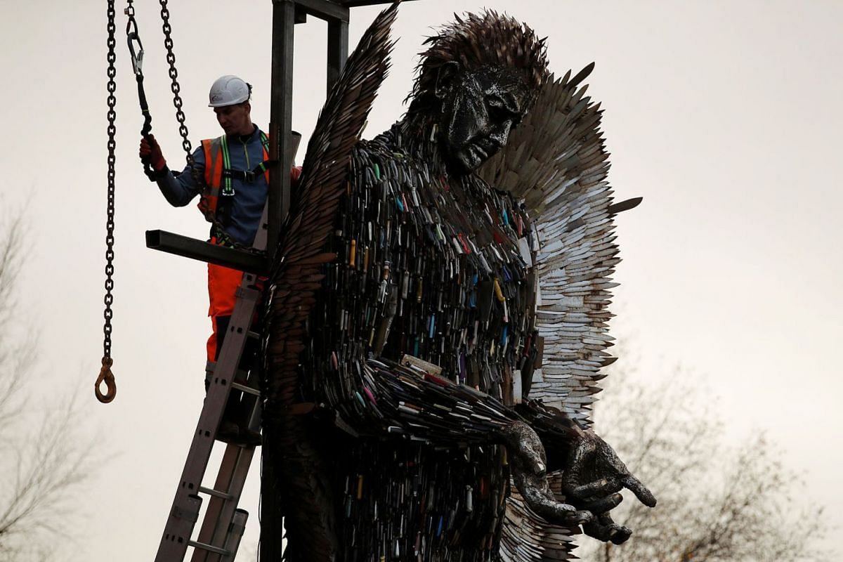 The 'Angel of Knives' sculpture by artist Alfie Bradley, made from over 100,000 confiscated knives, goes on display outside the Anglican Cathedral, in Liverpool, Britain, November 29, 2018.