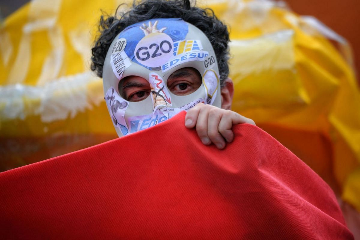 A protester is seen in front of the Congress building in Buenos Aires, Argentina, ahead of the 13th G20 Leaders' Summit on November 29, 2018