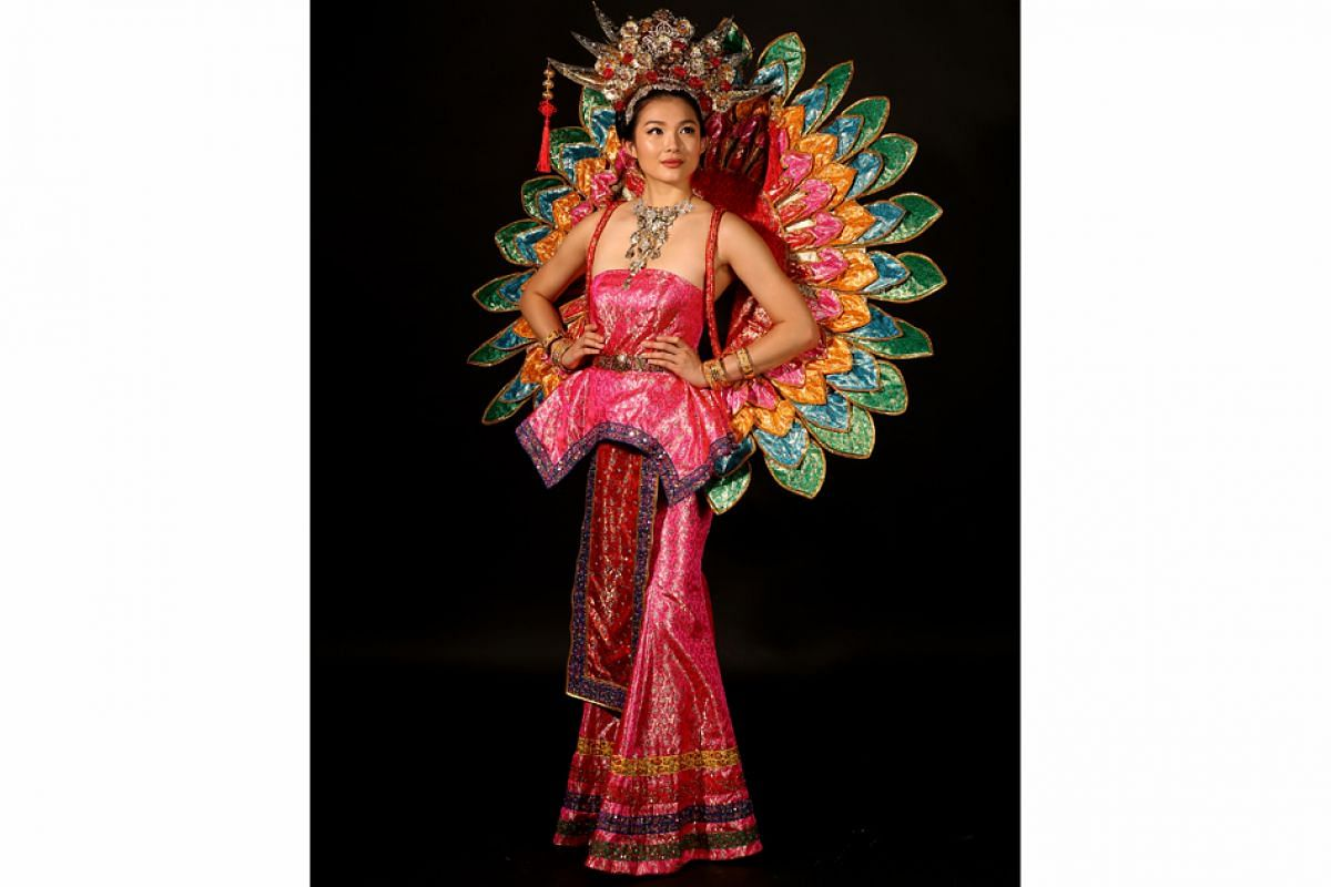 Past Miss Universe Singapore national costumes: Moe Kasim designed Miss Cheryl Chou's Peranakan wedding-inspired costume for 2016. The headpiece featured 500 Swarovski crystals.