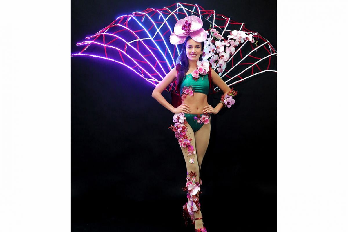 Past Miss Universe Singapore national costumes:: Miss Manuela Bruntraeger's costume last year, designed by Moe Kasim, was inspired by Gardens by the Bay's Supertrees. PHOTO: THE NEW PAPER FILE