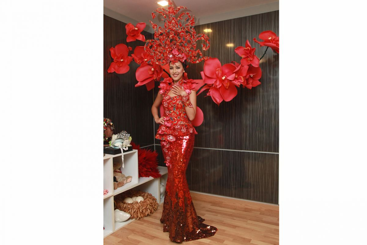 Past Miss Universe Singapore national costumes: Singapore couturier Frederick Lee designed the ethnic-inspired costume worn by Miss Lisa Marie White in 2015.