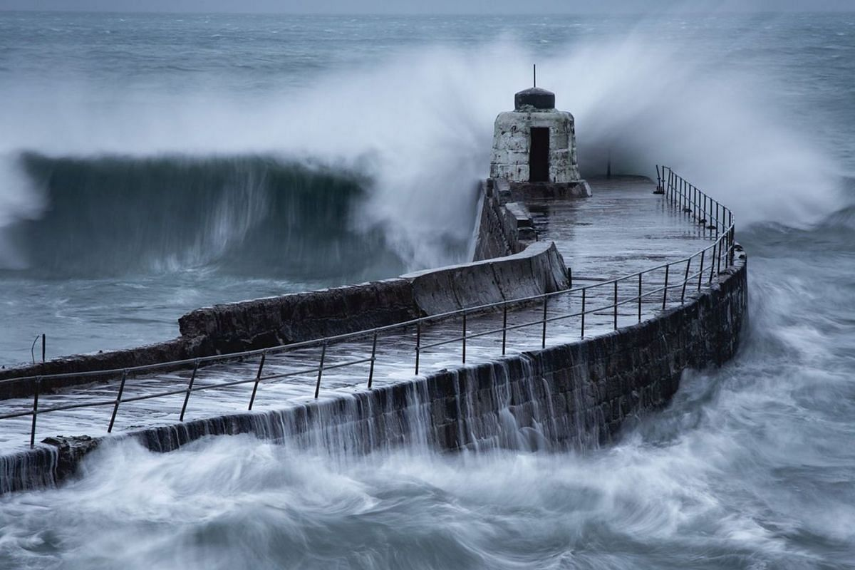 Waves hit the British coast as Storm Diana approaches, in Portreath, Cornwall, Britain, November 28, 2018, in this picture obtained from social media November 29, 2018.